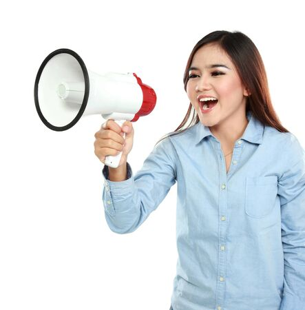 Young attractive asian woman shouting with a megaphone photo