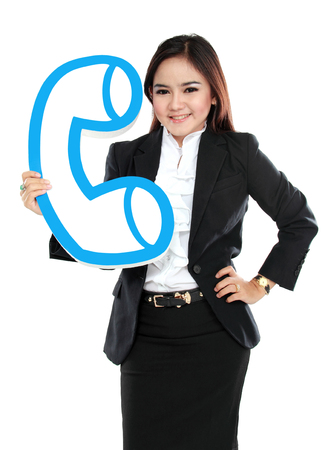 Portrait of businesswoman holding sign of telephone isolated over white  photo