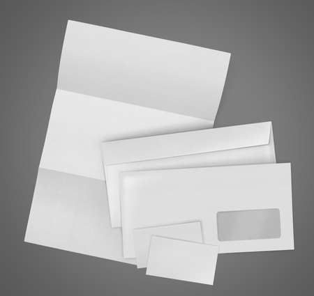 stationary set: business stationary set. envelope, sheet of paper and business card on gray