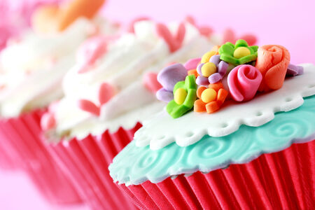close up of beautiful colorful wedding cupcakes photo