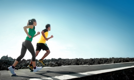 sport - asian couple running outdoor doing exercise Imagens