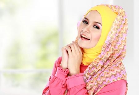 muslim girl: Fashion portrait of young happy beautiful muslim woman with pink costume wearing hijab
