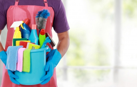 Portrait of man with cleaning equipment ready to clean house Stock Photo - 24658381