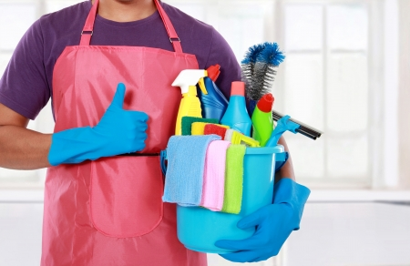 house cleaning: Portrait of man with  cleaning equipment showing thumbs up