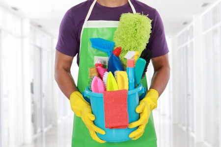 bright housekeeping: Portrait of man with cleaning equipment ready to clean house