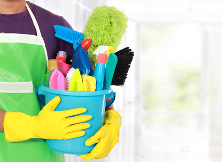 bright housekeeping: close up portrait of mans hand with cleaning equipment
