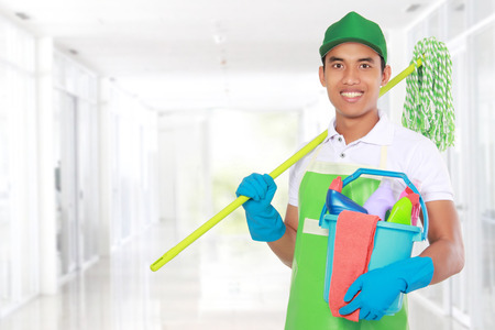 service occupation: Portrait of young man with cleaning equipment ready to clean the house
