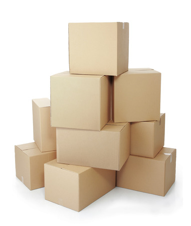 piles of cardboard boxes on a white background Фото со стока
