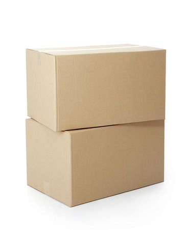 moving box: piles of cardboard boxes on a white background Stock Photo