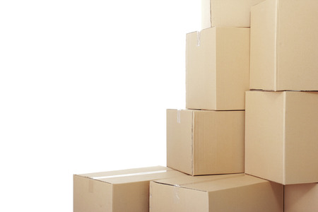 stockpiling: piles of cardboard boxes on a white background with copy space