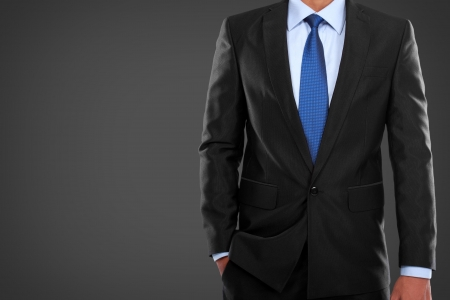 formal wear clothing: portrait of man in suit on a black background Stock Photo