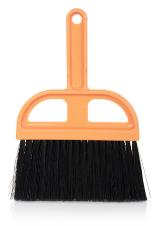 orange Plastic broom on isolated white background photo