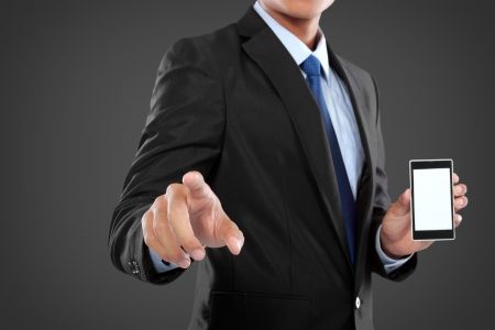pointing device: businessman holding mobile smart phone, while another hand touching to virtual touch screen Stock Photo