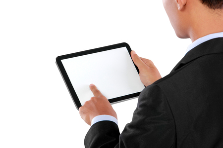 photo of a businessman using tablet PC  blank white screen ready for your design