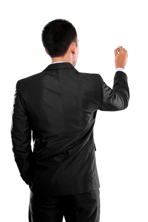 Business man writing or drawing to the blank space against white background photo