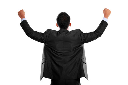 portrait of the back of business man with arms raised in success photo
