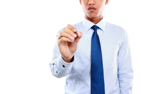 hand holding pen: Business man writing or drawing to the blank space against white background