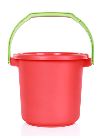 Red plastic bucket isolated over white background photo