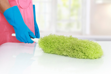 mopping: gesture of hand cleaning table using Soft duster Stock Photo
