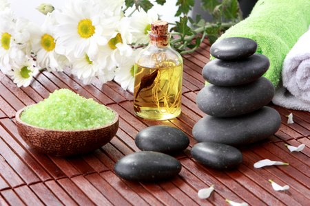 spa. zen basalt stones and flower on the wood photo