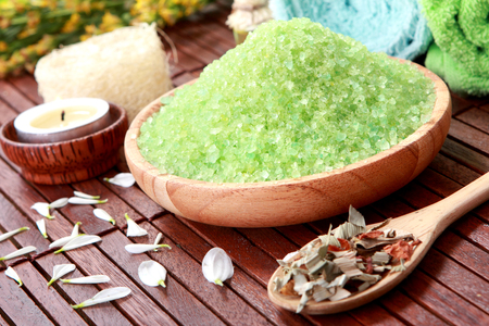 spa products. green spa sea salt on the wood photo