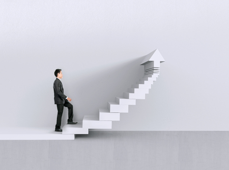 Image of confident businessman walking upstairs chart Stock Photo