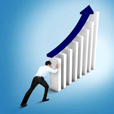 Businessman is trying to push and increase market statistics photo