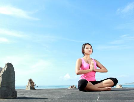 portrait of asian girl  doing meditation in the morning photo