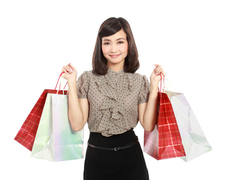 Shopping woman happy smiling holding shopping bags isolated on white background photo