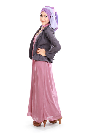 inviting: beautiful woman wearing pink muslim dress isolated on white background