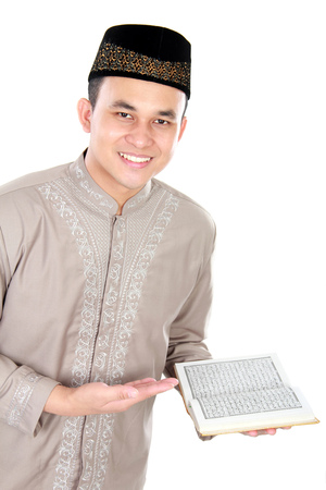 muslim man holding quran isolated over white background photo
