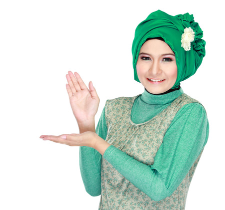 Portrait of beautiful young moslem woman presenting on white background