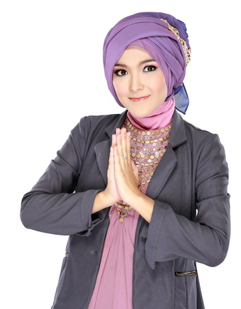 welcoming: beautiful welcoming girl wearing hijab smiling isolated on white background Stock Photo