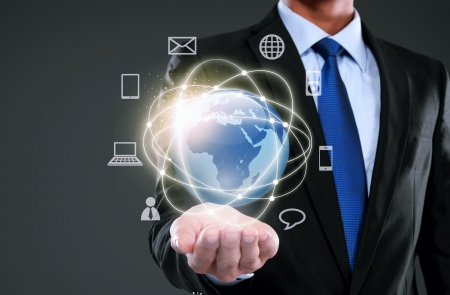 Businessman presenting global network media concept Stock Photo - 25348135