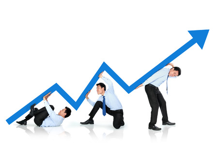 portrait of business man pushing up arrow together. growth chart concept photo