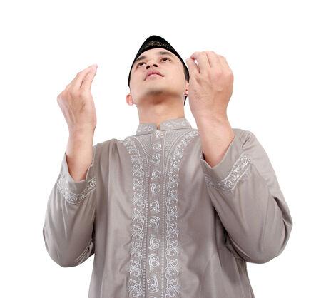 muslim pray: muslim man doing prayer isolated over white background