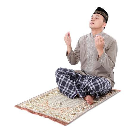 muslim man doing prayer isolated over white background