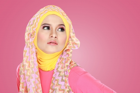 cover girls: Fashion portrait of young beautiful asian muslim woman with pink costume wearing hijab
