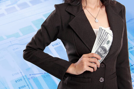 Business woman hiding money inside her jacket pocket on virtual financial background photo