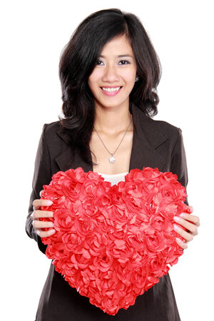 Business woman with red heart isolated on white Stock Photo - 25934790