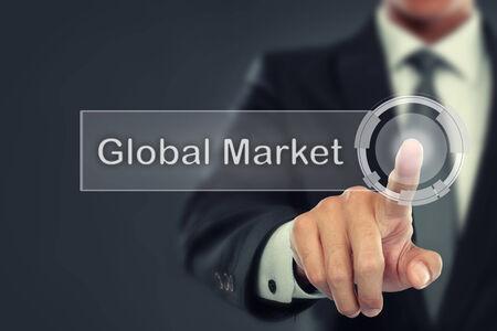 global market: portrait of Businessman push to  Global Market button on virtual screen