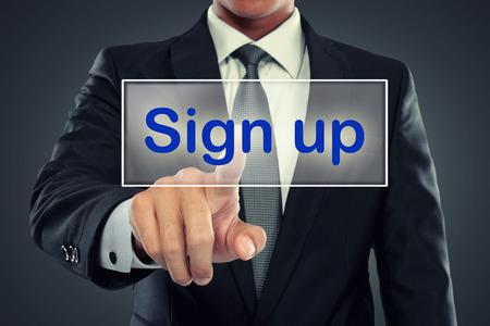 portrait of Businessman push to  Sign Up button on virtual screen photo