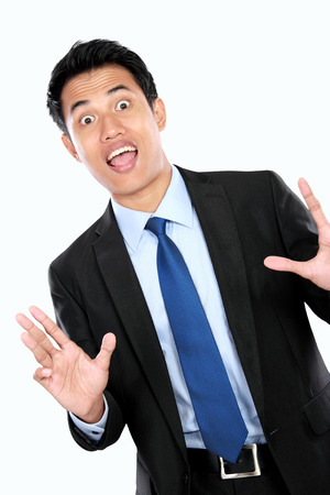 portrait of a shocked young businessman isolated on white background photo