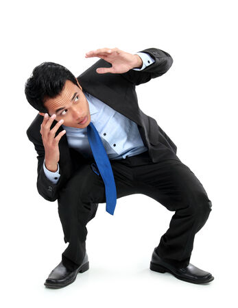 avoid: A view of a shocked young businessman isolated on white background Stock Photo