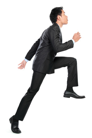 Businessman posing for conceptual photo of climbing up. isolated on white background photo