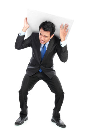 Businessman posing for conceptual photo. man holding something on his back Stock Photo