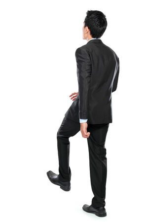 Businessman up the staircase over white background. ready for your design photo
