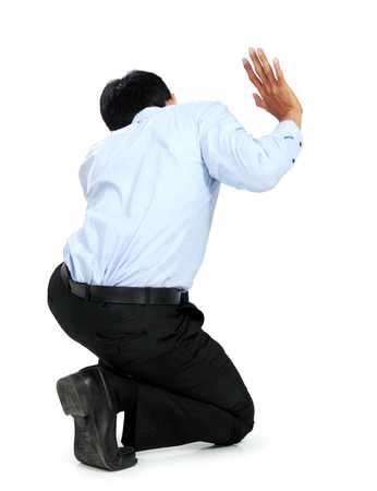 pinch: Businessman posing for conceptual photo on white background. push on blank space