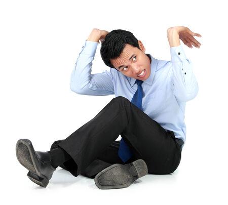 upward struggle: Portrait of businessman posing for conceptual holding something