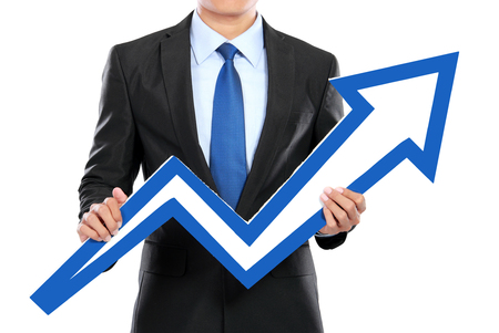 rise to the top: Portrait of businessman holding chart arrow sign isolated over white background Stock Photo